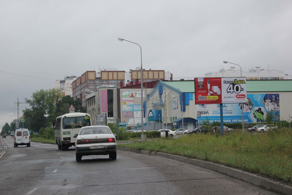 г. Северск, ул.Калинина, 157(Автостоянка перед Северским Ледовым Дворцом)